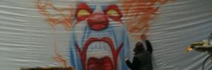Clown in Großformat mit Airbrushpistole gemalt